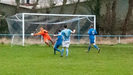 Carl Powell fires the opener against Outwell Swifts. Photo: Steve Snell