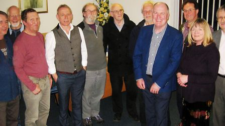 The guest speaker, David Maile, fourth from left, with members of the audience.