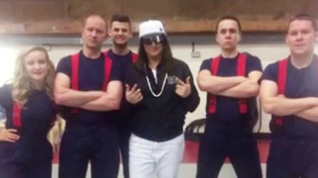 Honey G with members of the Cambridgeshire Fire & Rescue Service.