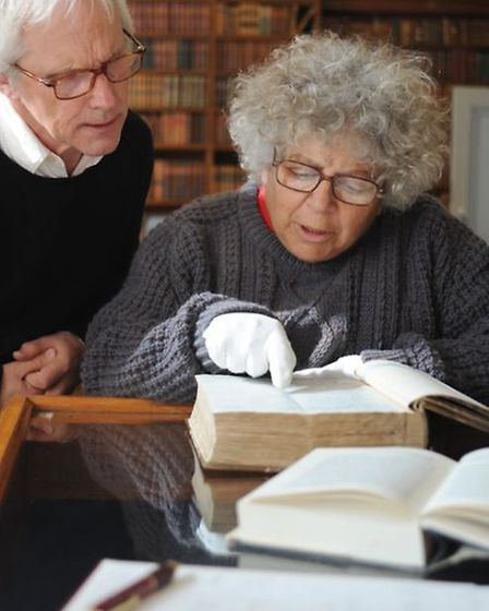Miriam Margoyles is shown the Great Expectations manuscript by museum curator David Wright pictured