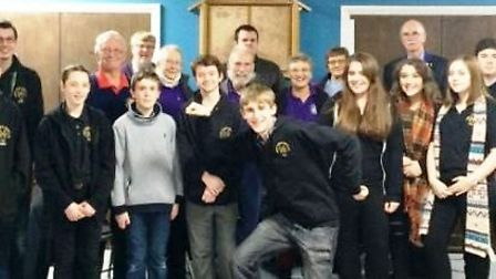 Volunteer Ross Usher with Young People March service users and staff.