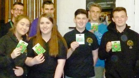 Young People March volunteers receiving awards for volunteering at YPM's junior club.