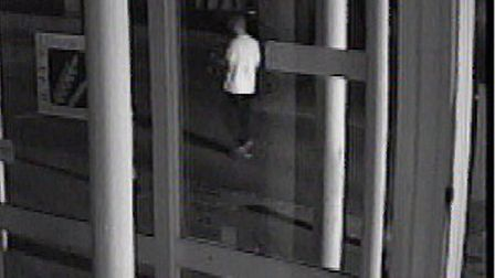 A man in a white T-shirt and dark bottoms, with short hair, at 3.21am in Cornhill Walk. Image 1.