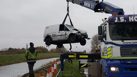 The van that failed to get away! Earlier reports that the driver catapulted across this Fen river we