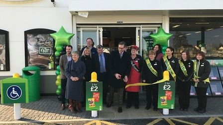 East Cambs District Council leader James Palmer (sixth left) opens the new 2 million BP Garage and M