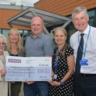 Mark Cross (centre), pictured here presenting a cheque for £6,000 to the Oncology department at Pete