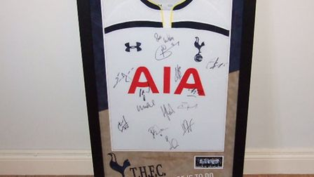 This Tottenham shirt, signed by the 2015/16 squad, is one of the lots at Mark Cross' Charity Darts D