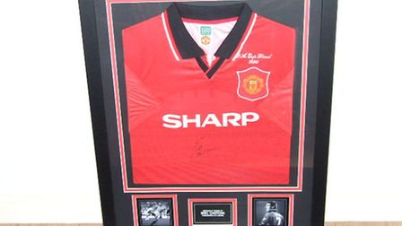 This Manchester United 1996 FA Cup final shirt signed by Eric Cantona is up for grabs at Mark Cross'