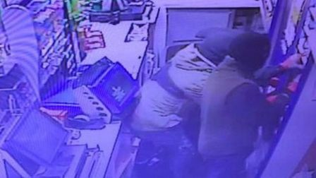 CCTV picture of burglars stealing cigarettes from the Lady Lane garage in Hadleigh, which has been l