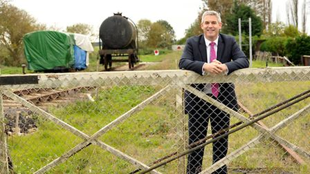 NE Cambs MP Steve Barclay pictured on the out of use Wisbech rail line, which is pushing to get re-o