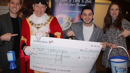 Producer Daniel Bell, Mayor of Ely Councillor Ian Lindsay and two cast members at the cheque present
