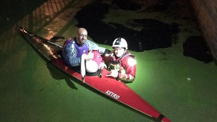 Volunteers had to take to the water in a kayak to save two swans from a drainage canal in Hampton ea