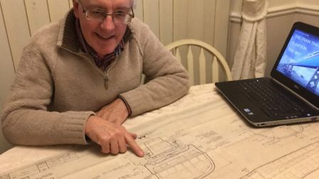 John Davis with the drawing of the passenger version of the hover train that he drew just before the