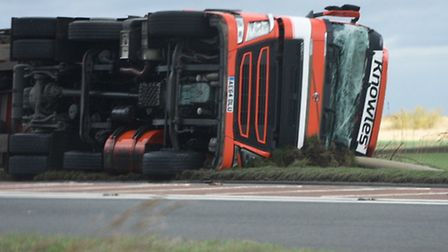 The A141 lorry is the third to have have left the road as high winds grip Fenland today (February 23