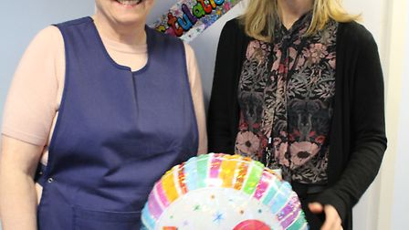Carol Brown celebrating 40 years as cleaner at St Mary's School, Great Dunmow with headteacher, Clar
