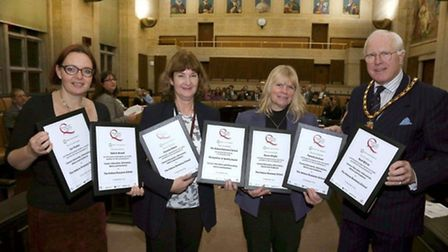 Helena Romanes staff receiving the Recognition of Quality Award at County Hall in Chelmsford.