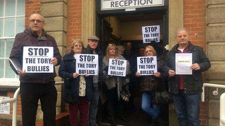 Protesters gather outside Fenland Hall in March before the start of a conduct committee hearing on C