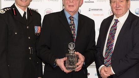 Burwell Watch Commander Les Fuller receiving The Chairman's Award, presented to him by Sir Peter Bro
