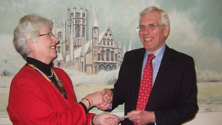President Mary Rone presenting cheque to John Wade.