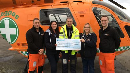 Magpas cheque presentation by staff at Fox Narrowboats in March L to R Chris Hawkins, Emily Syred, A