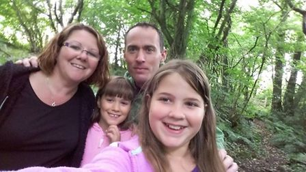 Isabel Coleman, 11, pictured with her parents Vicky and Marcus and younger sister Jasmine. Isabel is