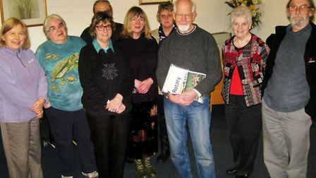 The numerous activities of March's Rotary Club were outlined by Alan Burdass (pictured centre) in hi