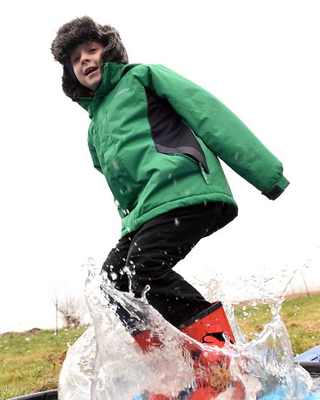 Russell Hartley taking part in the Welney Puddle Jumping Championships. PHOTO: Ian Carter.