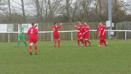 Ash Walter (centre) celebrates opening the scoring in Ely City's 2-1 win over Gorleston on Saturday.