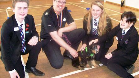 Bessie the puppy returned to Witchford Village College on Wednesday to help greet Year 6 students fr