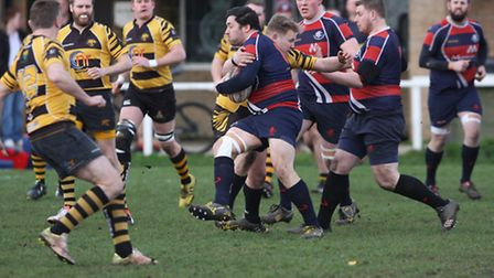 Nathan Brooks lands a big tackle in Ely Tigers' 37-6 victory over Stowmarket. PHOTO: Steve Wells