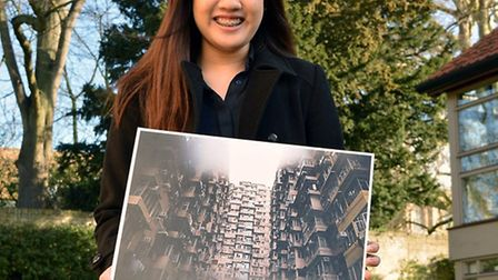 King's Ely sixth form student Charmaine Wong with her photograph 'Central Hong Kong,' which came in