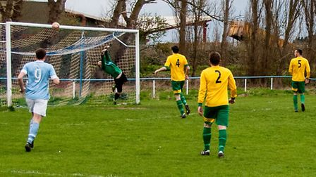 Craig Gillies looks on as Lakenheath goalkeeper Ian Fawcett makes another fine save in his side's 1-