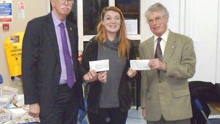 March Lions' Ian Groom (left) and March Rotary Club President Nicholas Kime (right) donated £600 to