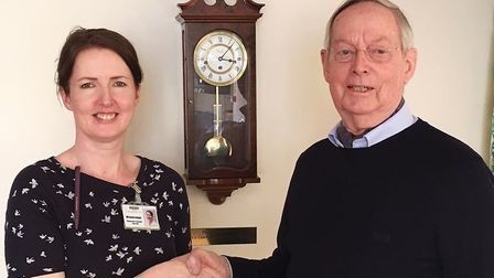 Derek Walker presents Michelle Knight, Matron at the Alan Hudson Day Treatment Centre, with funds ra