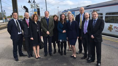 MPs Liz Truss (fourth right) and Lucy Frazer (third left) visited Ely Rail Station today (March 24)