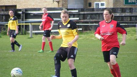 March Town Ladies' Jade Pointer and Rachael Simpson of Wisbech Town Ladies in action during the loca