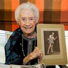 Joan McAdams holds up a picture of herself in her singing hey-day. Picture: Alison Jenkins