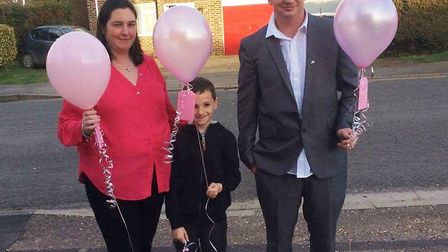 Emma Saunders, her son Connor Fyson and her partner Steve Fyson released pink balloons in memory of