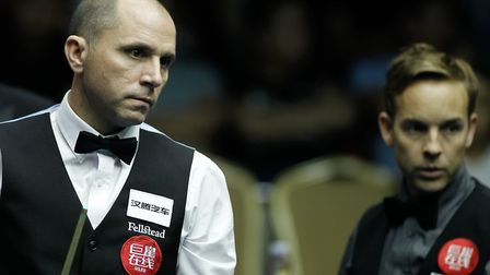 Joe Perry progressed into the second round of World Snooker Championship qualifying after beating Za
