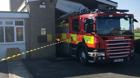 A fire engine bears the brunt of the collapse of Manea fire station due to faulty brickwork.