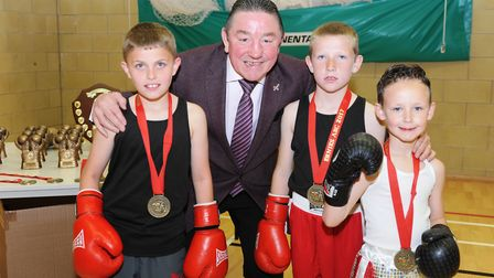 Dave 'Boy' Green with some of the young boxers that took part in Ernie's ABC's Home Show. PHOTO: Rob
