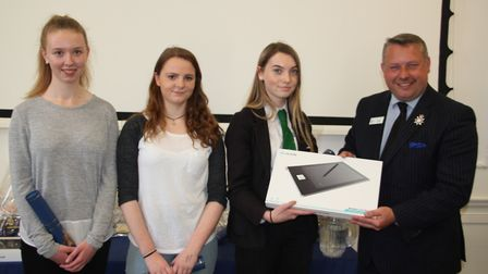 Eve Henderson of Soham Village College picks up her prize from police and crime commission Cllr Jaso