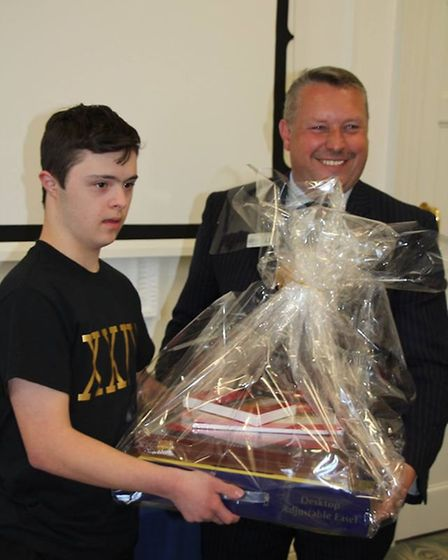 Police and crime commissioner Cllr Jason Ablewhite presents one of talented artists with his prize i