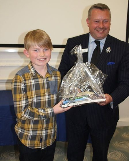 Police and crime commissioner Cllr Jason Ablewhite presents one of the prizes in the Policing East C