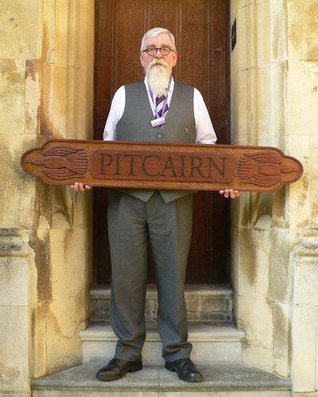 Pete Welford of Burwell has created a carving for hte Pitcairn Island Study Centre in California, Am