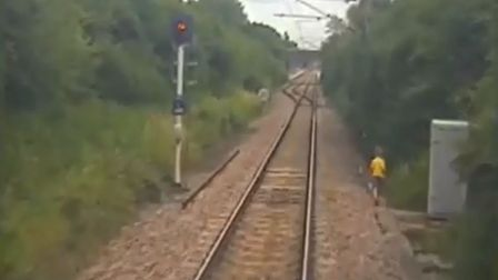 Trespass footage of a young boy at the side of the railway in the Anglia region PHOTO: Network Rail