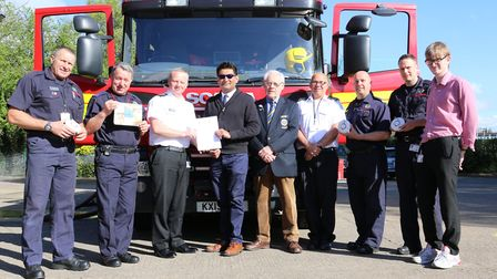 Rotary Club of Wisbech with Cambridgehire Fire and Rescue crew Station Commander Brett Mills, from W