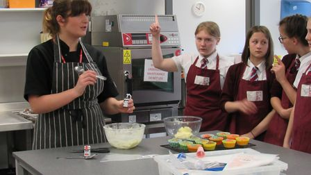 Chef Emily's Easter cake decorating demonstration is a hit with Cromwell students. PHOTO: Jackie Har