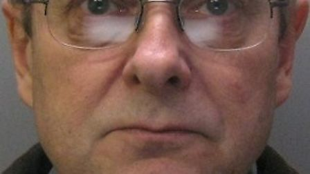 Andrew Brown, 61, claimed a man who burgled his house placed indecent images on devices he had stol
