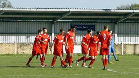Ely City celebrate Kelvin Enaro's opening goal in their 1-1 draw at Wivehoe Town on Saturday. PHOTO: